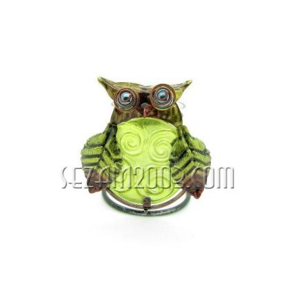 Candlestick with owl of metal and glass
