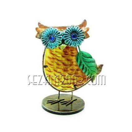 Owl of glass and metal