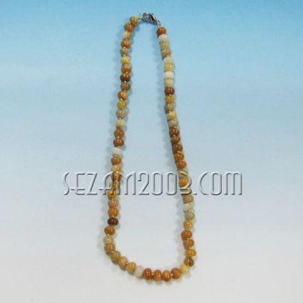 Колие обработени камъни -оранжев калцит-ф,8мм  с възли