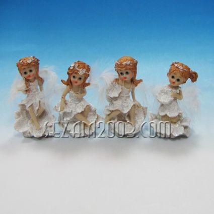 ангелче  с крила от пух -фигура от полирезин
