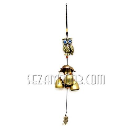 pendant / wind bell made of brass with a coin figure