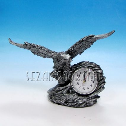 Eagle with a clock - a figure of pElephant figure of polyresinolyresin