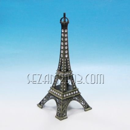 Eiffel tower of metal with stones