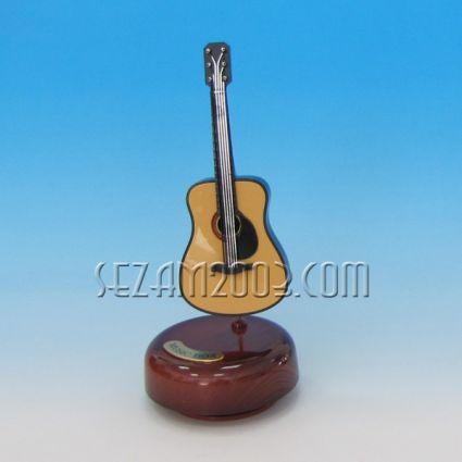 Guitar - a rotating souvenir with a musical mechanism